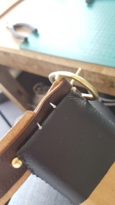 Stitching the buckle in place