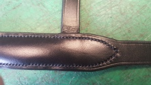 Raised noseband showing intricate 12 holes to an inch stitching