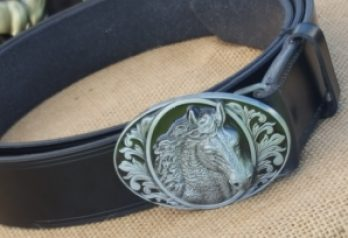 An equine-themed belt buckle