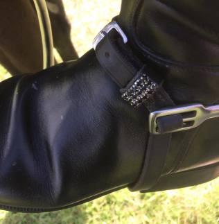 Close up shot of Robyn Walker's black diamante spur straps